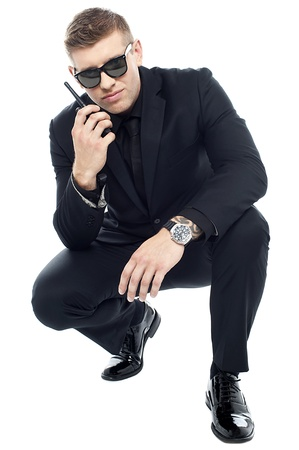 Handsome security officer investigating and communicating about the clue found on the floor Stock Photo - 15351736