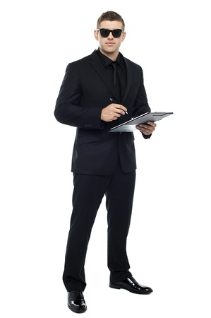 Male bouncer holding clipboard isolated against white background photo