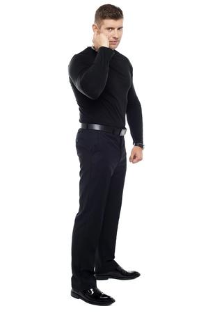 Strong bouncer listening carefully. Full length shot over white background Stock Photo - 15351604