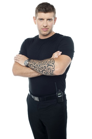 Bouncer with walkie-talkie. Tattoo on hands, posing in style photo