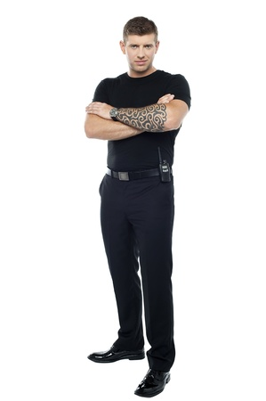 Bodyguard with tattoo. Posing with folded arms, looking at you Stock Photo - 15351614