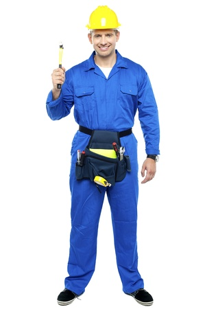 Industrial contractor holding hammer. Full length shot over white background photo