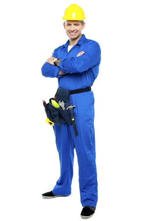 Portrait of confident smart construction worker. Arms folded and posing photo