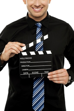 Cropped image of man with clapboard. Isolated on white photo