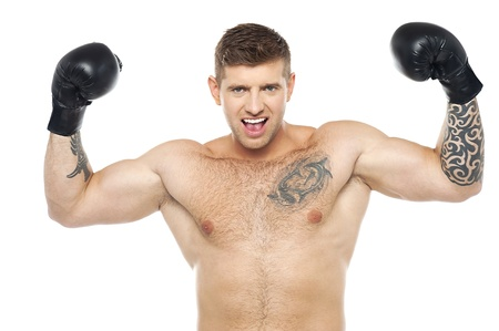 Attractive young boxer posing strongly with raised arms. Won fight photo