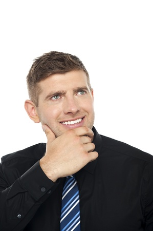 Smart young business consultant thinking, Hand on his chin, closeup shot photo