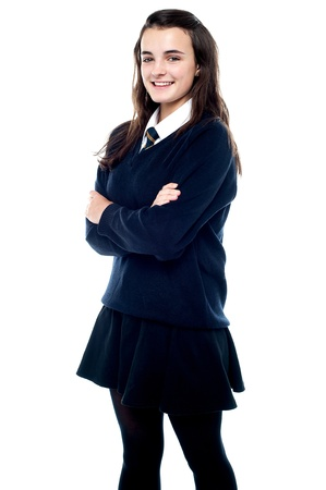 hair tie: Snapshot of a cheerful schoolgirl in uniform. All on white background Stock Photo