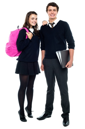 best schools: Full length snap shot of cheerful classmates posing together Stock Photo