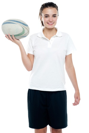 rugby football: Lovely isolated caucasian teenager with a football over white background Stock Photo