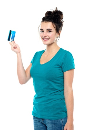 Pretty girl ready to make use of her cash card. Its shopping time! Stock Photo - 15714988