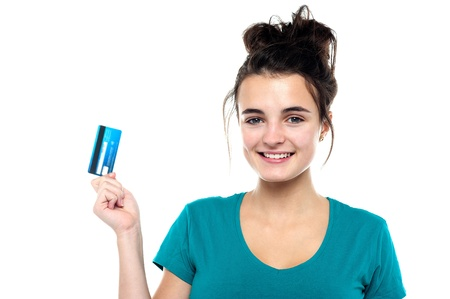 Smiling cute girl posing with her credit card isolated against white background Stock Photo - 15714967
