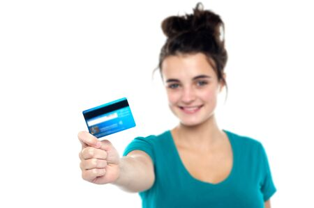 Girl showing her cash card, arm stretched out. Focus on card Stock Photo - 15714927