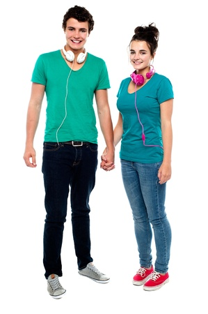 We share love for music. Full length portrait of charming couple holding hands Stock Photo - 15714982