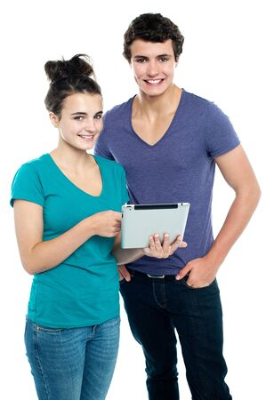 Technology savvy couple browsing newly launched tablet in market. Likely to buy it Stock Photo - 15715009