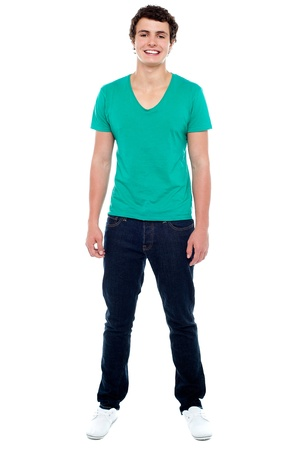 standing man: Full length portrait of casual teenager looking at camera and smiling Stock Photo