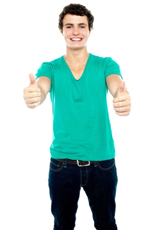 Guy showing thumbs up, arms stretched out. Isolated over white Stock Photo - 15714956