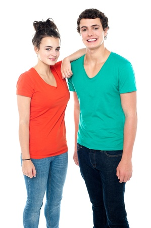 casuals: Adorable teenage couple in casuals isolated on white background Stock Photo