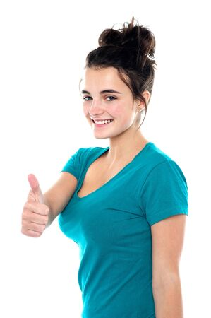 yup: Gorgeous pretty girl showing thumbs up to you. Casual shot
