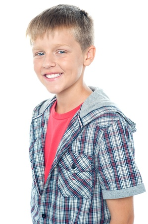 Cheerful young caucasian boy posing. All against white background photo