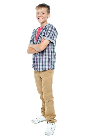 Confident young casual 12 years old boy posing in style with arms crossed Stock Photo - 15895574