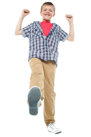 Isolated enthusiastic child enjoying himself. White background Stock Photo - 15895611