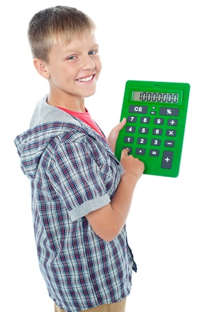 Pleasant young student using a large green calculator and looking at the camera Stock Photo - 15895647
