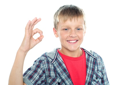 Enthusiastic young student flashing a perfect sign isolated over white background Stock Photo - 15895640