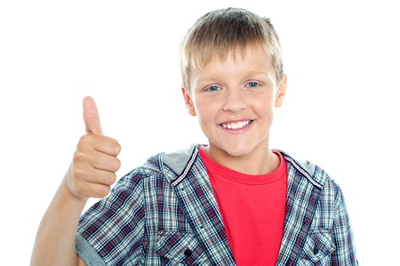 Boy in trendy clothes looking at the camera and showing thumbs up sign Stock Photo - 15895645