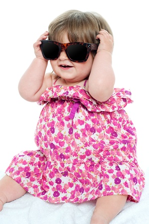 Cute little toddler wearing classy shades. Having fun and great time photo