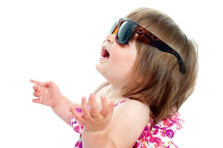 over sized: Baby girl wearing over sized sunglasses. Looking up and enjoying herself