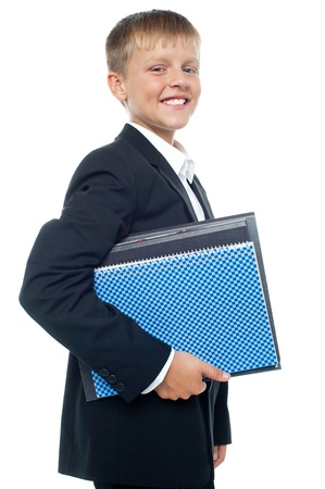 Cheerful little boy holding business files posing confidently Stock Photo - 15895619