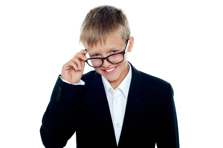 Young business boy looking through his glasses. Taking a closer look Stock Photo - 15895576