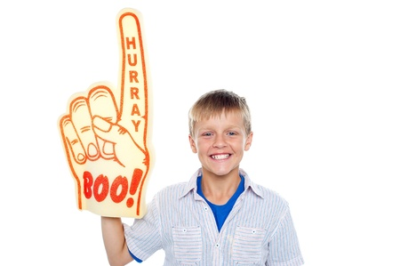 hurray: Handsome boy with a hurray boo foam hand pointing skywards on isolated white background