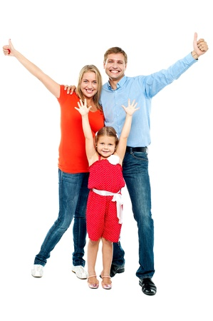 family looking up: Beautiful smiling family. Father, mother and daughter. All on white background