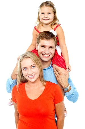 facing the camera: Portrait of cheerful family of three having fun. Facing camera and smiling