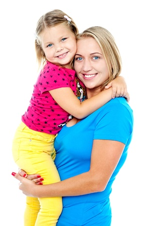 Cute daughter hugging her mom. Casual shot. All on white background photo