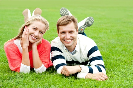 Couple outdoors enjoying a summery day. Looking happy photo