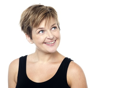 A lady with short hair turning away from the camera with an amused look on her face Stock Photo - 16167225