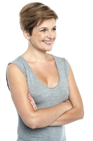 sexy middle aged woman: Portrait of beautiful female model on white background. Arms folded, looking away Stock Photo