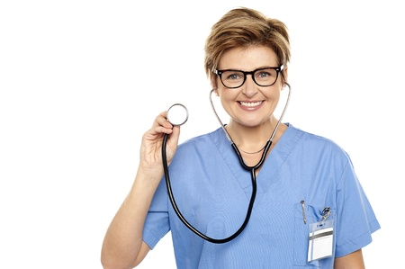 Senior female physician ready to examine you. All on white background photo