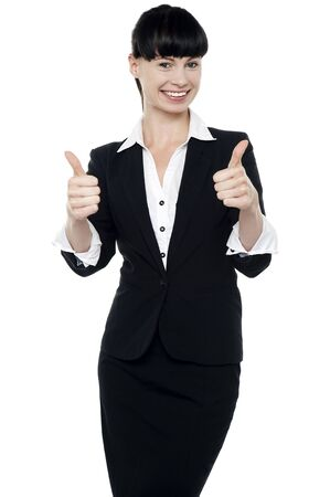 Successful businesswoman gesturing thumbs up isolated over white Stock Photo - 16405356