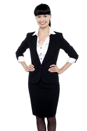 smartly: Smartly dressed woman with hands on her waist. All on white background