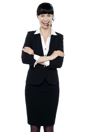 Charming female customer support executive engaged in a conversation. Wearing headsets Stock Photo - 16405352