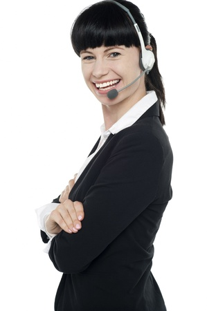 Friendly female telephone operator at your service. Isolated on white Stock Photo - 16405337
