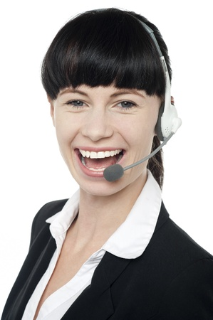 Close up portrait of customer service operator laughing and enjoying work with headset on photo