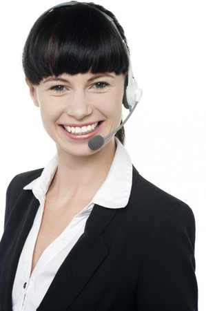 Modern girl with headset on facing the camera and smiling. Tight closeup Stock Photo - 16405313