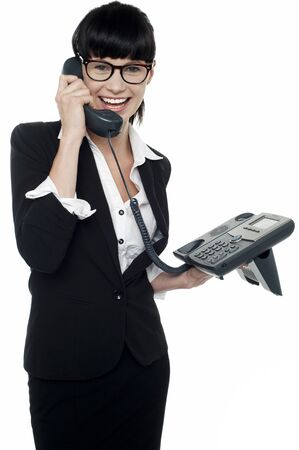 Professional lady speaking on phone. Enjoying her conversation photo