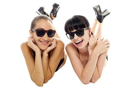 Pretty models having a good time together. Relaxing and facing the camera. Stock Photo - 16469235