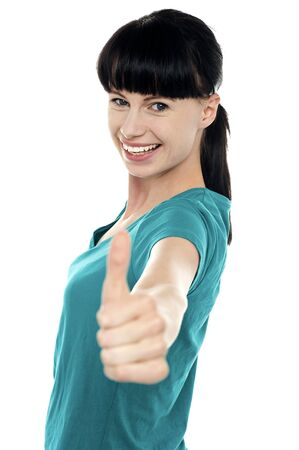 posing  agree: Attractive woman showing thumbs up gesture isolated against white background Stock Photo