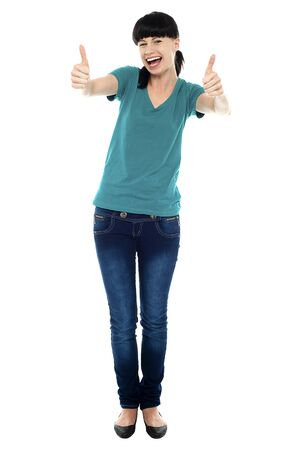Amused woman on white background gesturing double thumbs up Stock Photo - 16469330